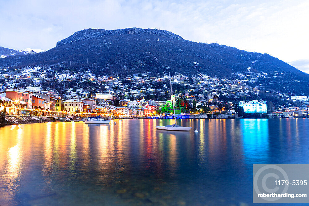 Historic buildings of Gravedona with Christmas Lights during a winter sunrise, Lake Como, province of Como Lombardy, Italy