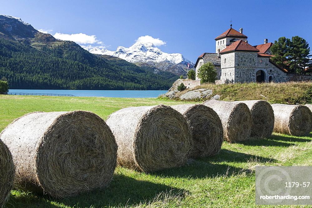 Haystacks lying on the bank of Lake Sils in Silvaplana, by Saint Moritz, Graubunden Switzerland, Europe