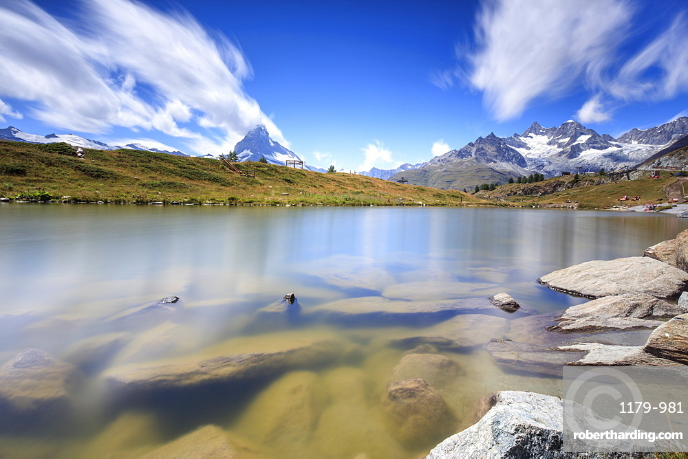 Lake Leisee frames the Matterhorn and the high peaks in the background in summer, Zermatt, Canton of Valais, Swiss Alps, Switzerland, Europe
