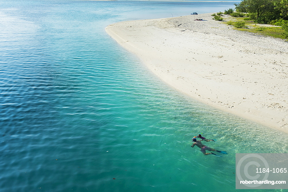 Man snorkeling in the beautiful lagoon of Ouvea, Loyalty Islands, New Caledonia, Pacific