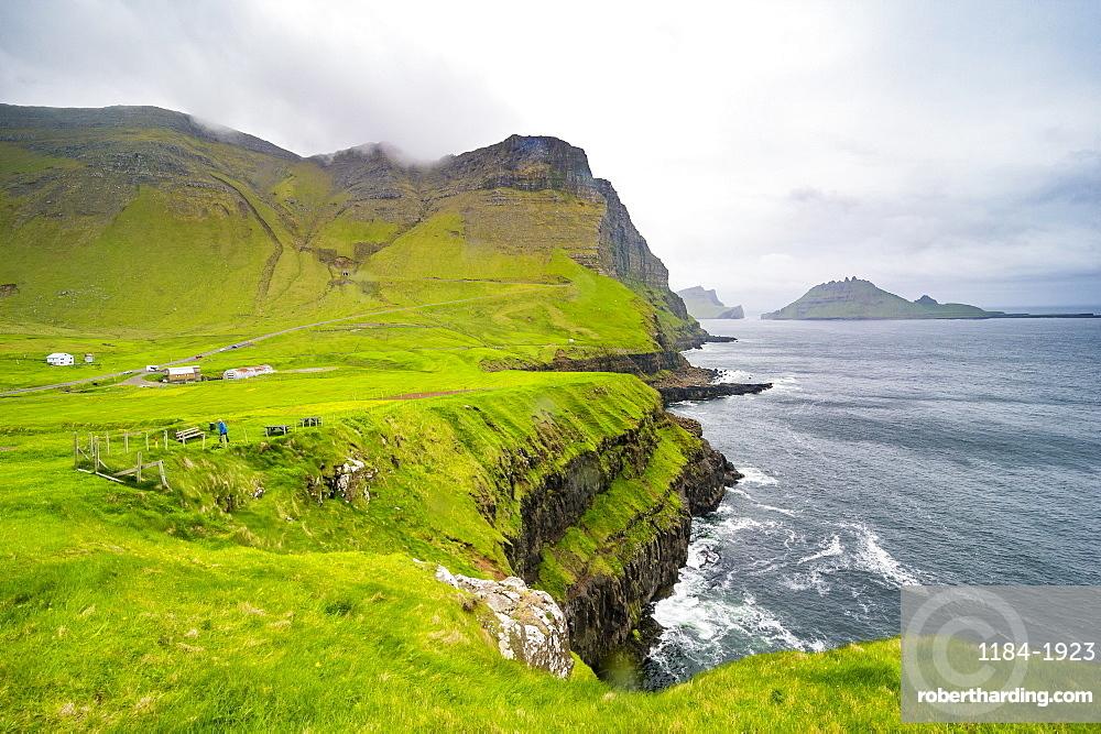 Huge cliffs in Gasadalur, Vagar, Faroe islands, Denmark
