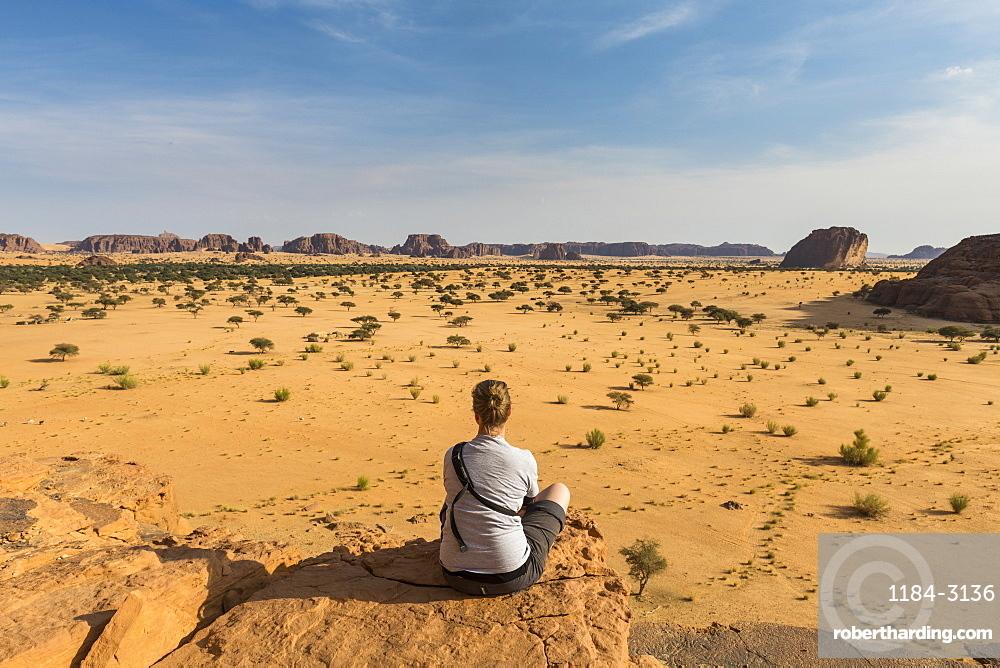 Woman enjoying the beautiful scenery, Ennedi Plateau, UNESCO World Heritage Site, Ennedi region, Chad, Africa