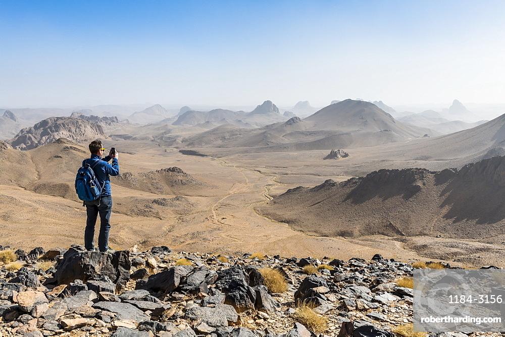 Man enjoying the mounains of Assekrem, Tamanrasset, Hoggar mountains, Algeria, North Africa, Africa
