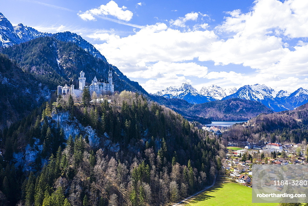 Aerial of Castle Neuschwanstein, with the Alps behind, Schwangau, Bavaria, Germany, Europe
