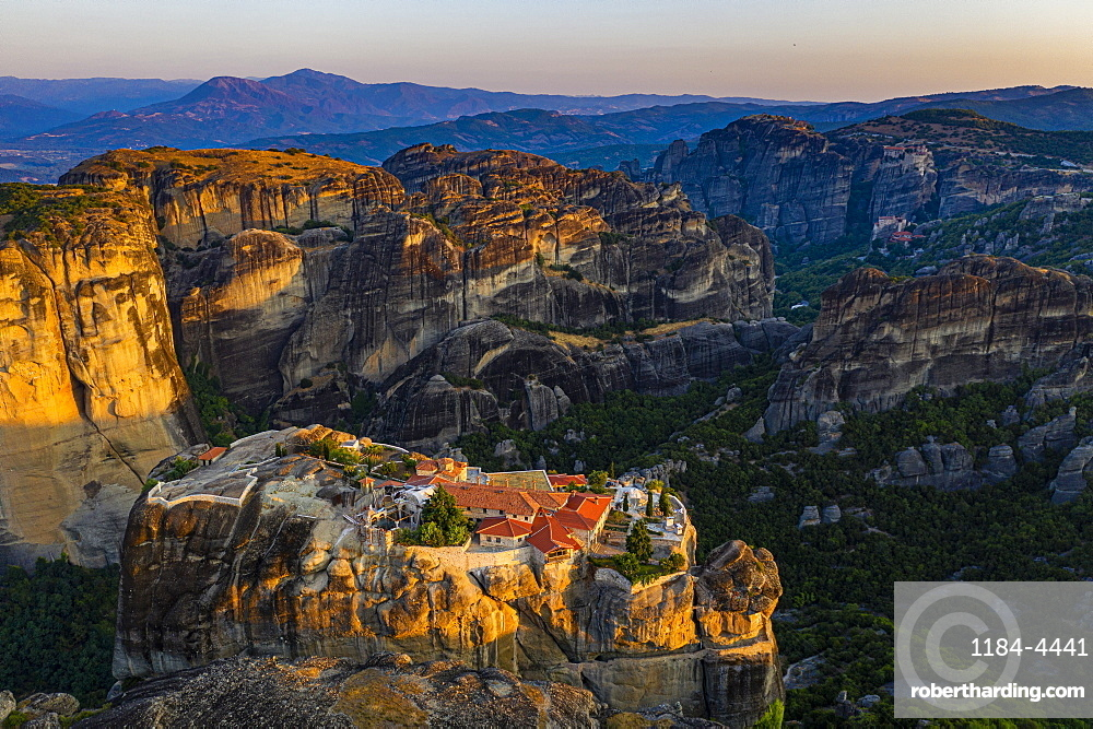 Aerial of the Holy Monastery of Holy Trinity at sunrise, Unesco world heritage site Meteora monateries, Greece (drone)