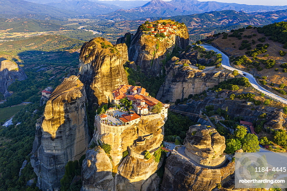 Aerial by drone of the Holy Monastery of Varlaam at sunrise, UNESCO World Heritage Site, Meteora Monasteries, Greece, Europe