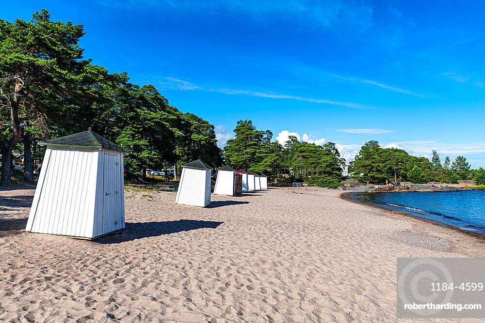 Beach huts on a deserted beach, Hanko, southern Finland, Europe