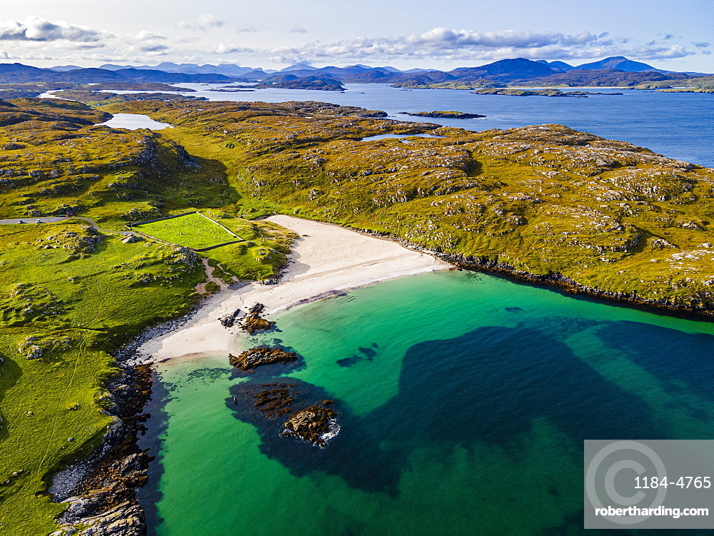 Aerial of white sand and turquoise water at Bosta Beach, Isle of Lewis, Outer Hebrides, Scotland, United Kingdom, Europe