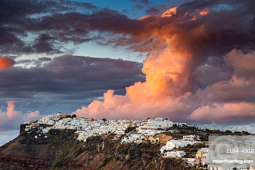 Whitewashed houses on the caldera at sunset, Fira, Santorini, Greece