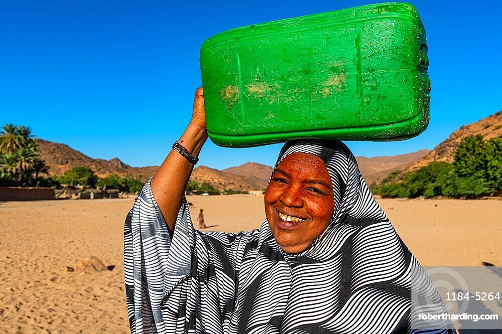 Woman carrying a water container on her head, Oasis Timia, Air mountains, Niger
