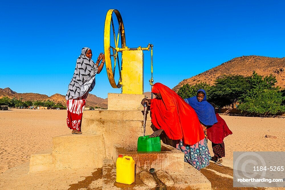 Local women at a waterwell, Oasis Timia, Air mountains, Niger
