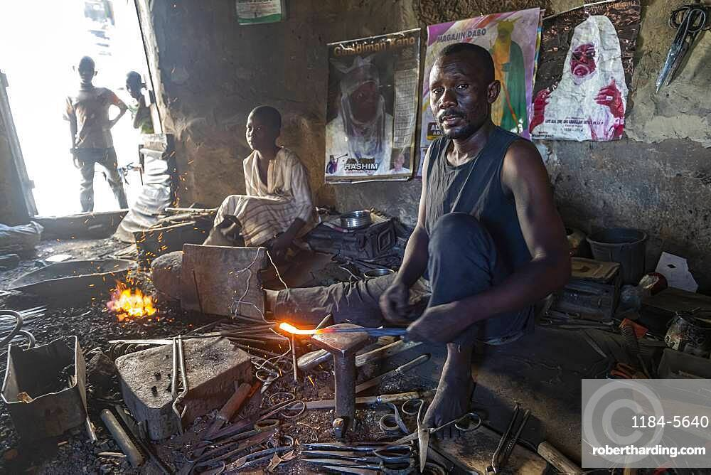Metal workers in the bazaar, Kano, Kano state, Nigeria, West Africa, Africa