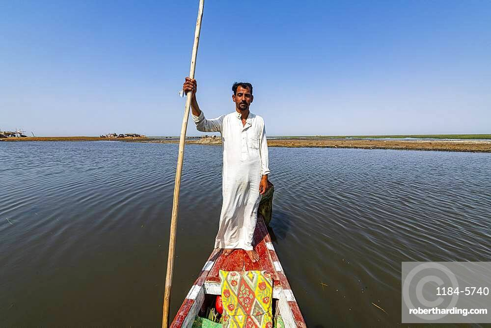Marsh Arab on his boat, Mesopotamian Marshes, The Ahwar of Southern Iraq, UNESCO World Heritage Site, Iraq, Middle East