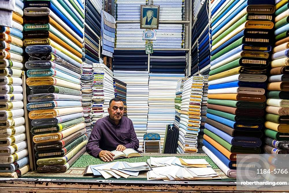 Man in his cloth shop in the Imam Ali Holy Shrine, Najaf, Iraq