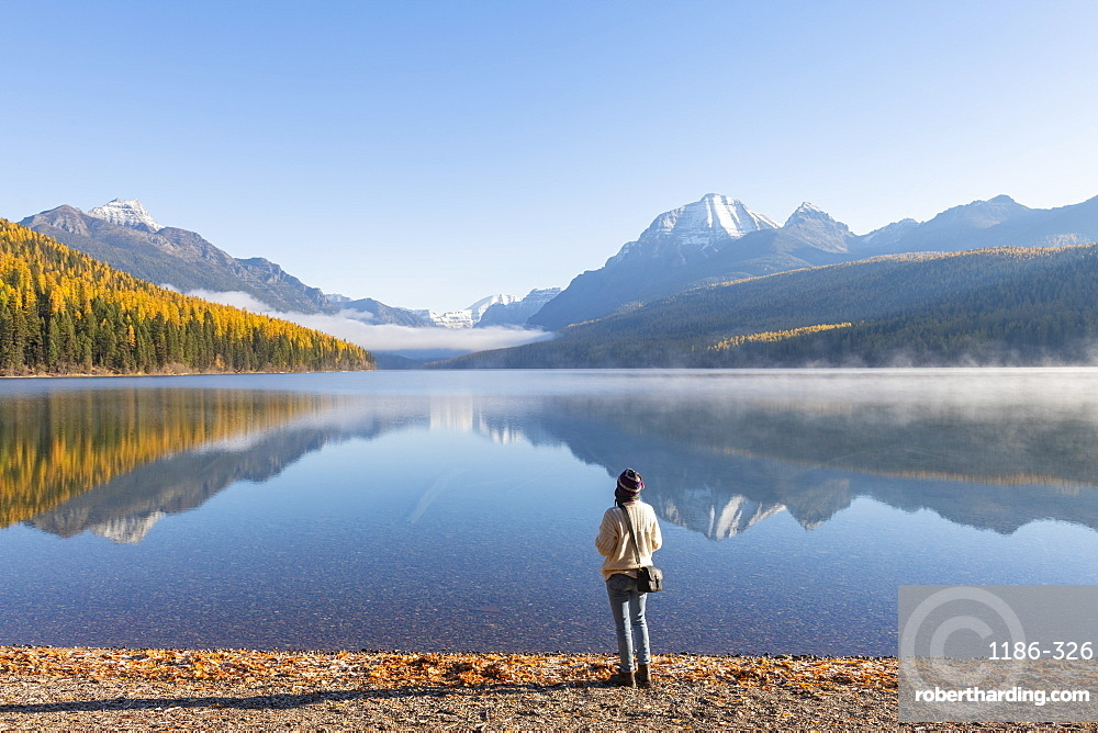 Woman on the shores of Bowman Lake, Glacier National Park, Montana, United States of America, North America