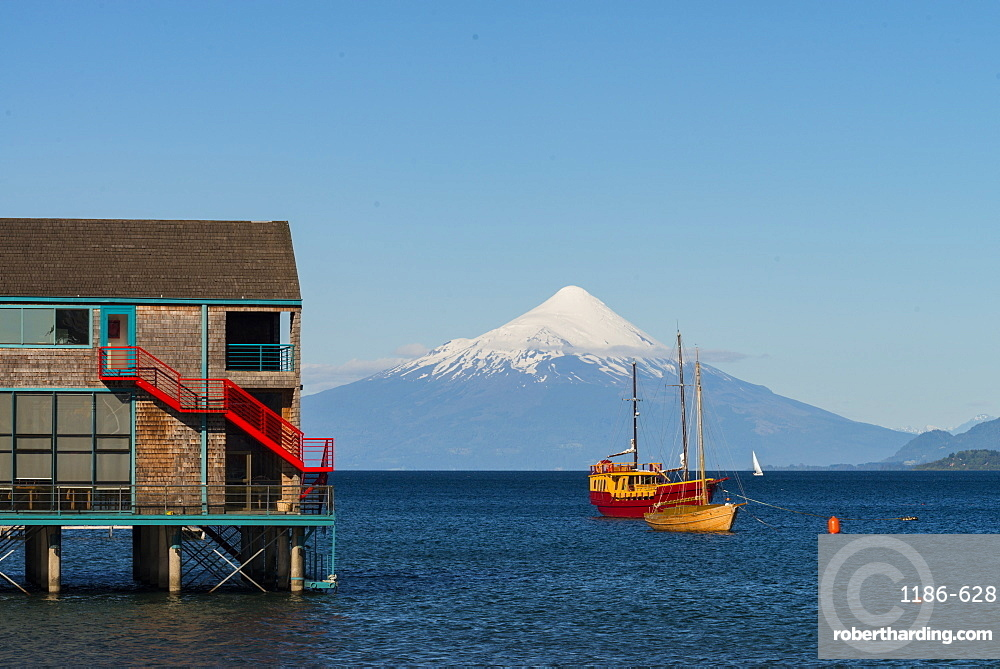 Boat and boat house in lake Llanquihue and Volcan Osorno, Puerto Varas, Chilean Lake District, Los Lagos, Chile, South America