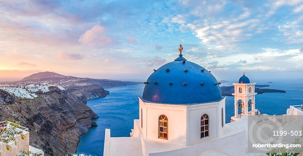 Sunrise shot of the Church in Imerovigli, looking over to Fira and the Caldera of Santorini, Santorini, Cyclades, Aegean Islands, Greek Islands, Greece, Europe