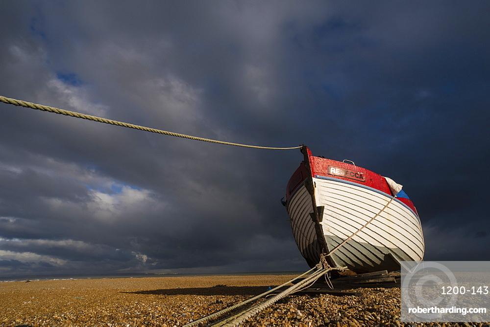 Boat on shingle beach, Dungeness, Kent, England, United Kingdom, Europe