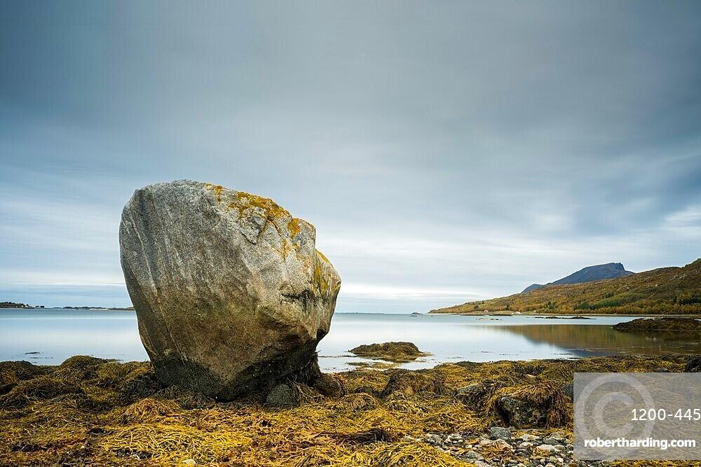 Large rock at low tide, west Senja, Norway, Scandinavia, Europe