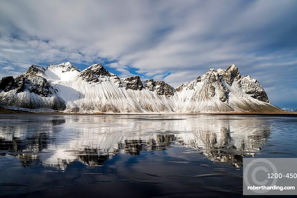 Vestrahorn Mountain reflected in wet sand, Iceland, Polar Regions