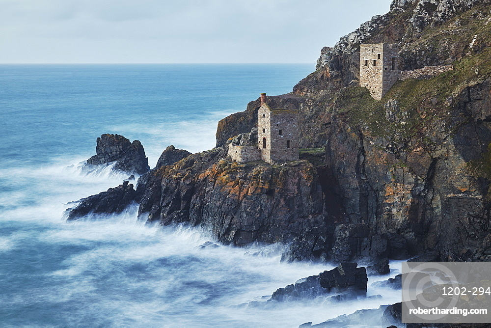 A dusk view of the iconic cliffside ruins of Botallack tin mine, UNESCO World Heritage Site, near St. Just, near Penzance, in west Cornwall, England, United Kingdom, Europe
