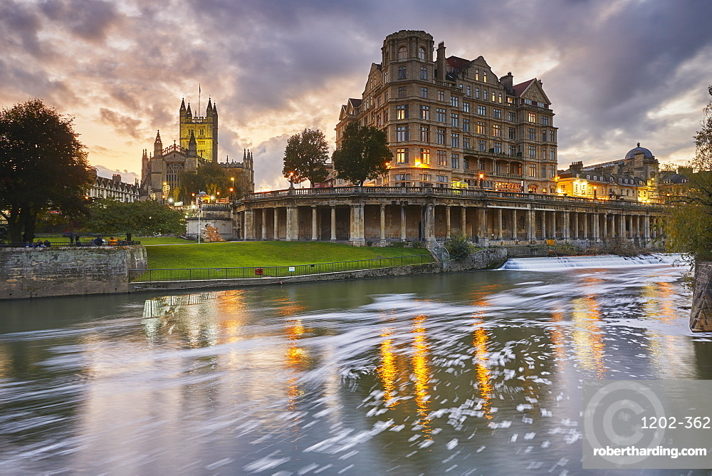 A dusk view along the River Avon, with Bath Abbey, in the heart of Bath, Great Britain.