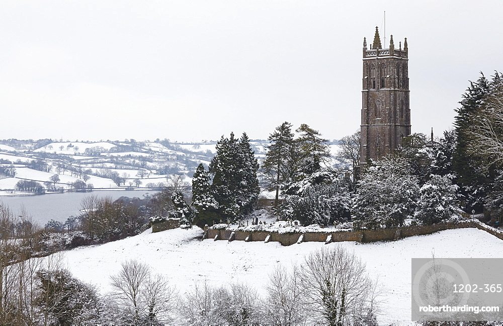 A wintry view of Blagdon Church, with Blagdon Lake in the background, Blagdon, Somerset, Great Britain.