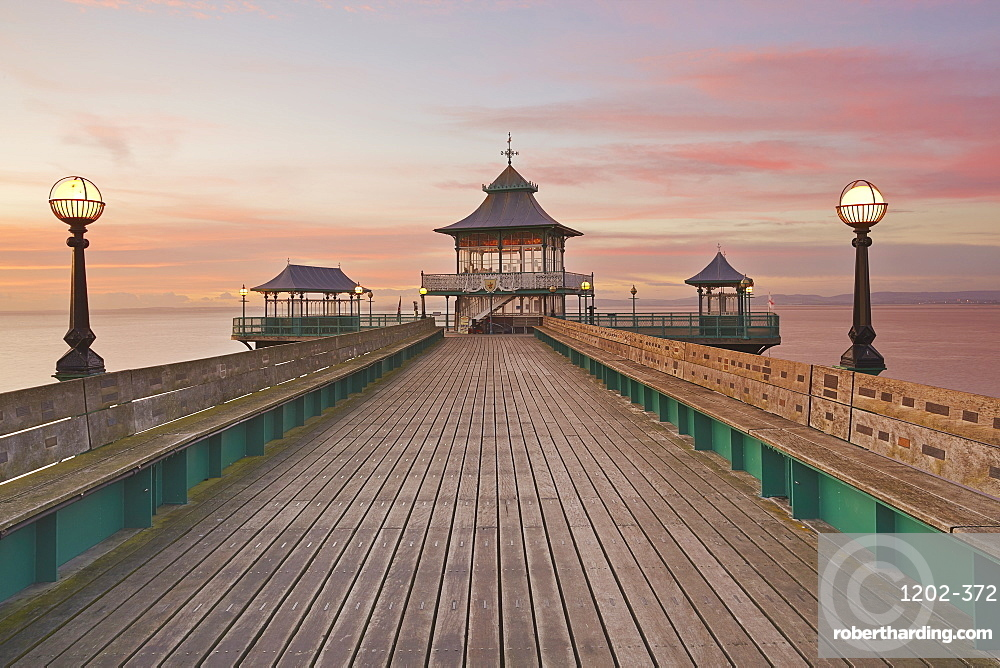 A dusk view of Clevedon Pier, in Clevedon, on the Bristol Channel coast of Somerset, Great Britain.