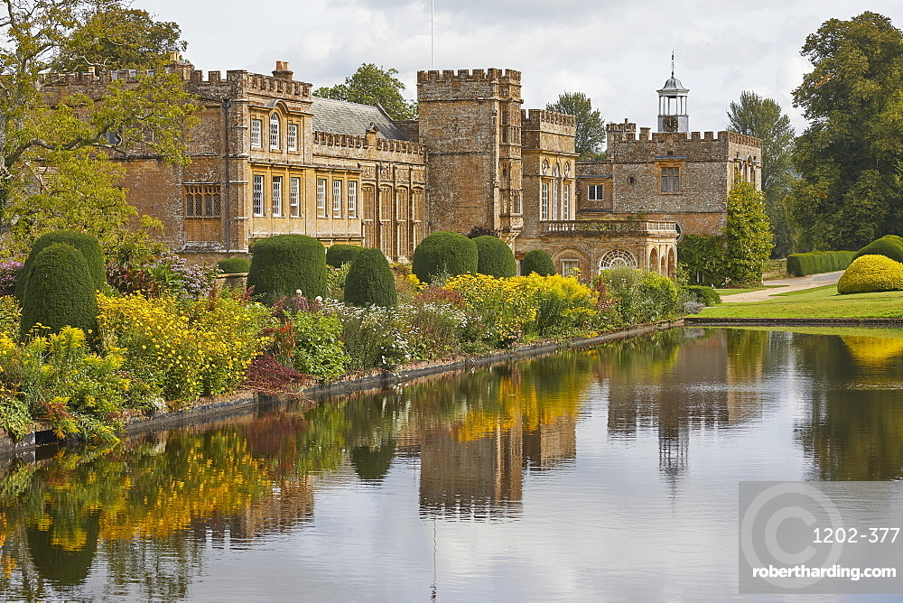 The abbey buildings seen across the Long Pond, at Forde Abbey and Gardens, near Chard, Somerset, Great Britain.