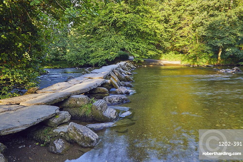The prehistoric slab stone bridge, Tarr Steps, crossing the River Barle, near Dulverton, in Exmoor National Park, Somerset.