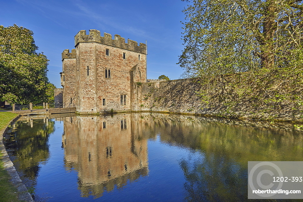 The historic Bishop's Palace and its moat, at Wells Cathedral, in Wells, Somerset, Great Britain.