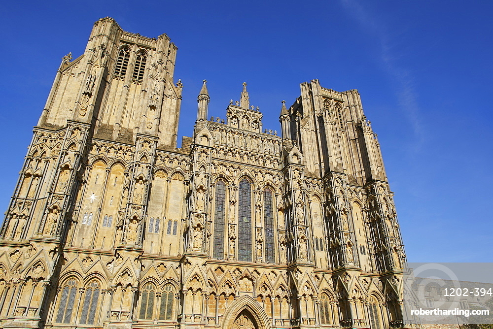 The historic western facade of Wells Cathedral, with its twin square towers, in Wells, Somerset, England, United Kingdom, Europe