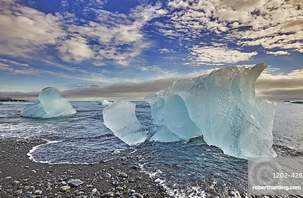 Melting glacial ice, carved from the Vatnajokull icecap, on the beach at Jokulsarlon, on the south coast of Iceland, Polar Regions