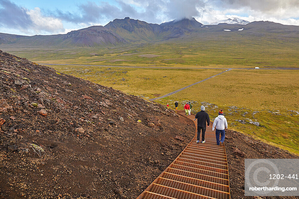 Exploring a volcanic landscape on a footpath up Saxholl cinder cone and crater, Snaefellsjokull National Park, western Iceland, Polar Regions