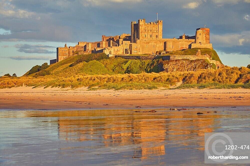 Bamburgh Castle and its beach, at Bamburgh, near Seahouses, Northumberland, England, United Kingdom, Europe