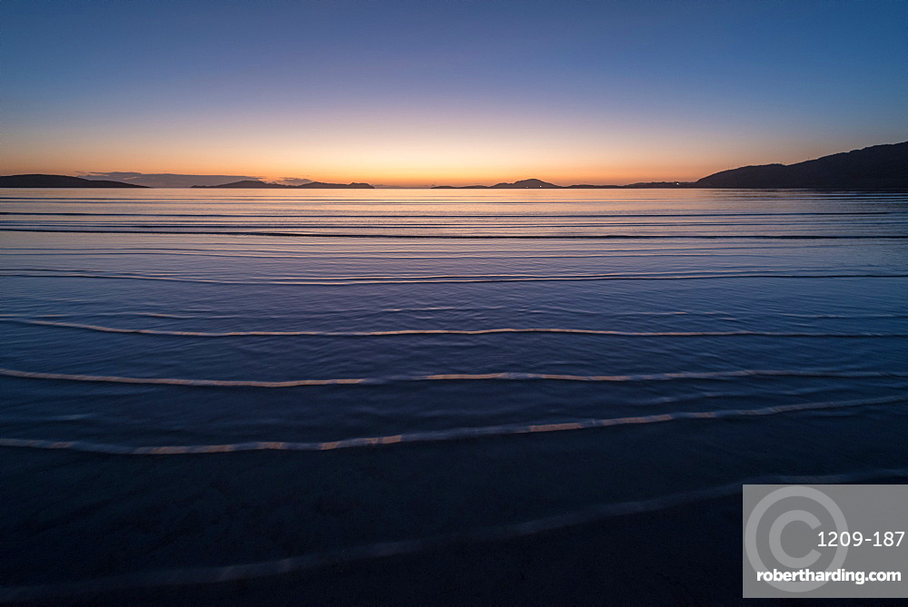 Winter sunrise at high tide, Traigh Mhor, the beach used as Barra Airport at low tide, Barra, Outer Hebrides, Scotland, United Kingdom, Europe