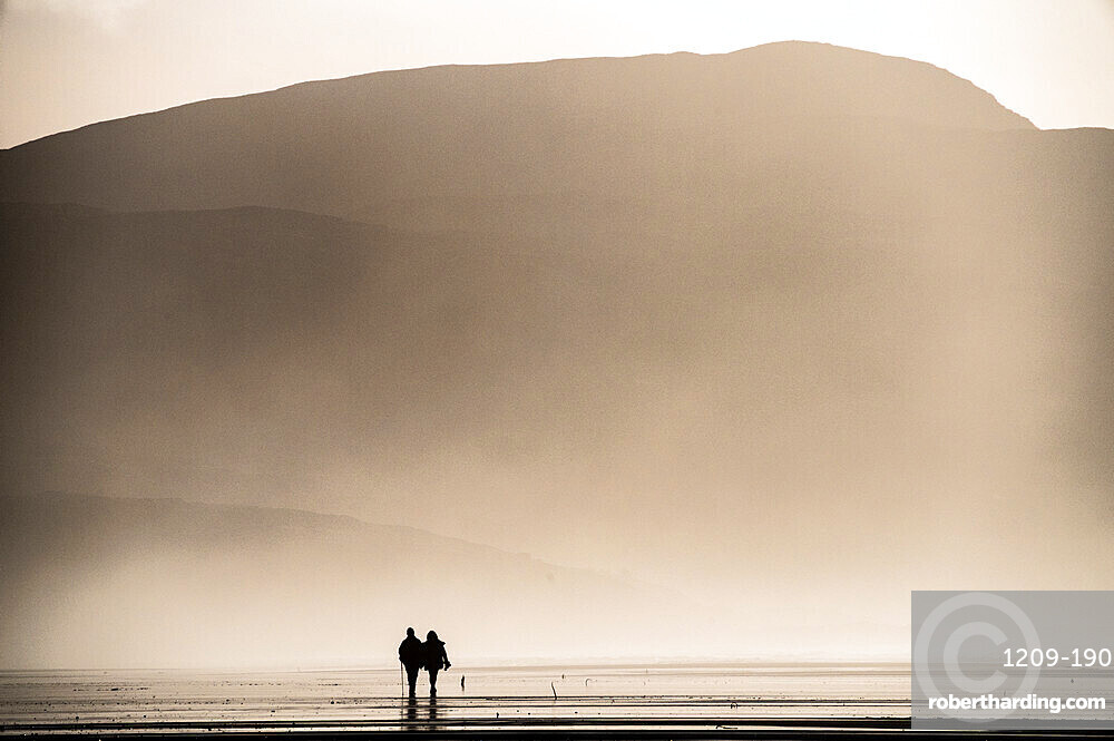 Couple taking a Sunday afternoon walk on Traigh Eais, Barra, Outer Hebrides, Scotland.