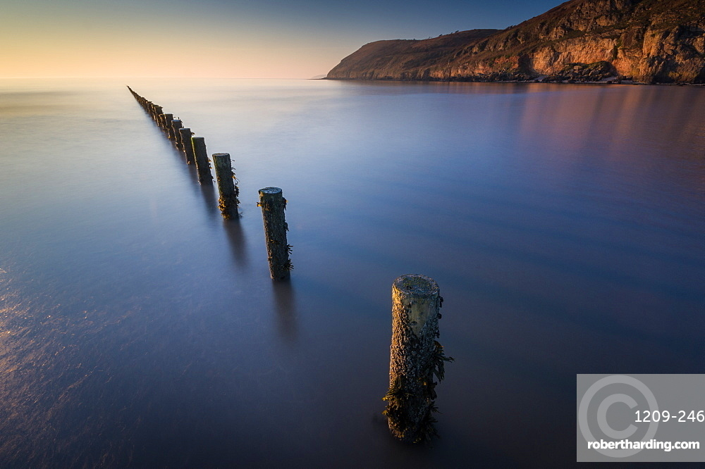 Groynes, Brean Beach, with Brean Down in far distance, Somerset, England, United Kingdom, Europe