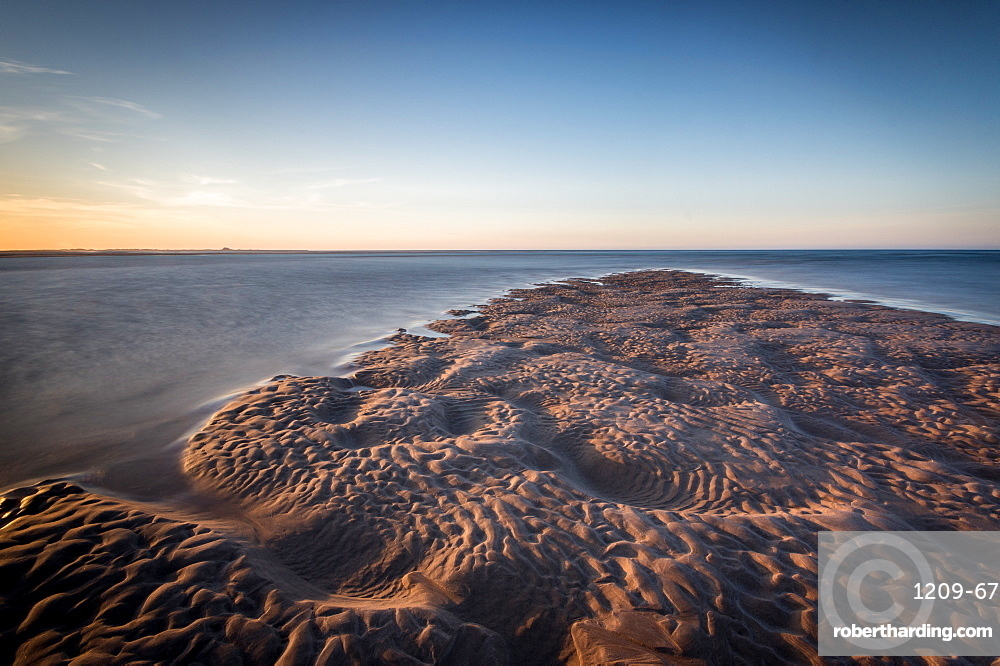 Sand formations at Budle Bay, with Holy Island Castle in the distance, Northumberland, England, United Kingdom, Europe
