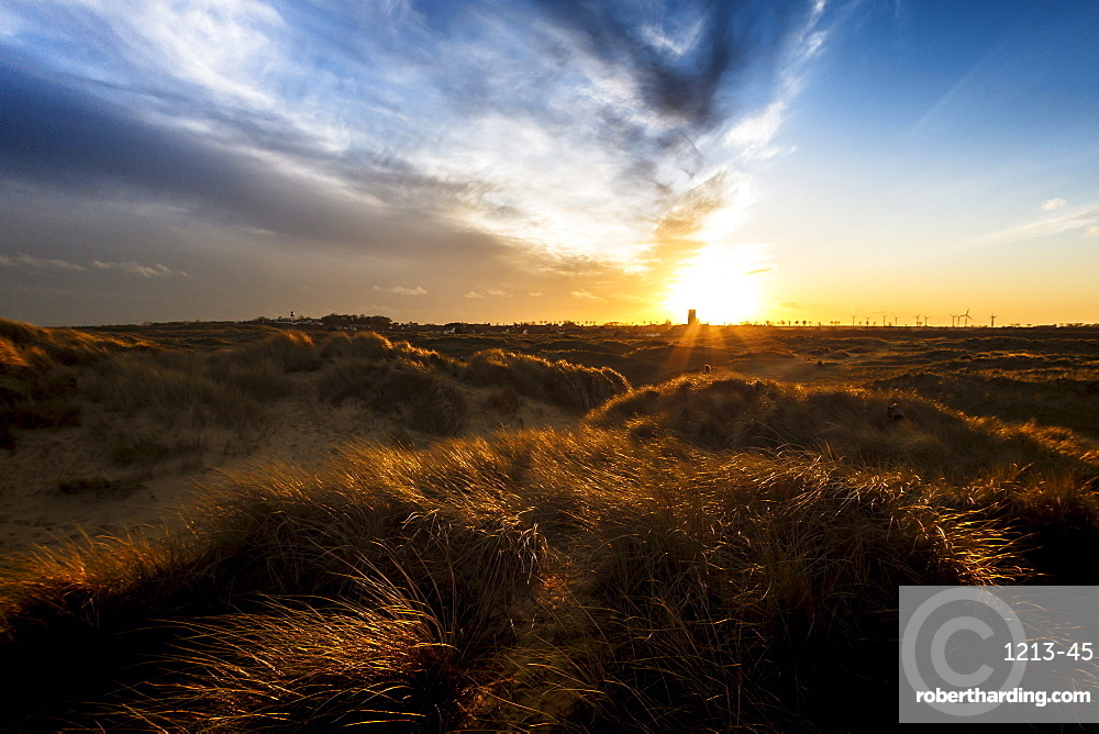 Sunset over the dunes and the Parish Church of the Holy Trinity and All Saints at Winterton on Sea, Norfolk, England, United Kingdom, Europe
