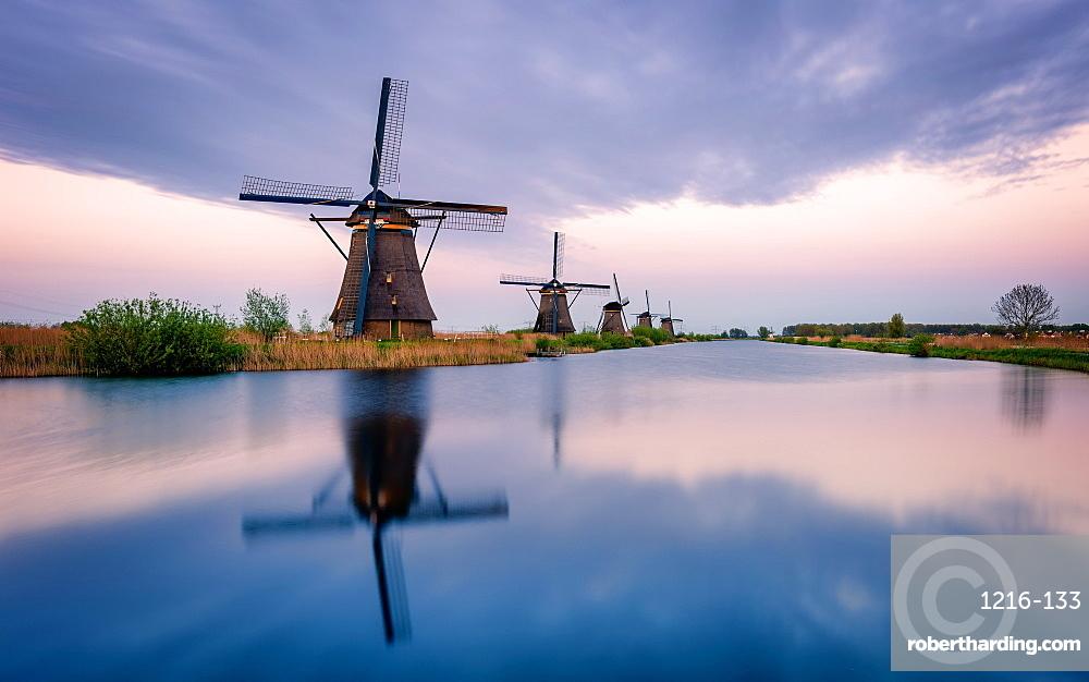 Windmills and reflections, Kinderdijk, UNESCO World Heritage Site, The Netherlands, Europe