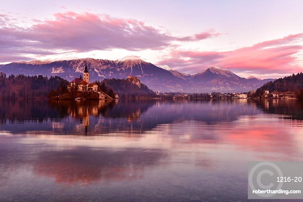 Lake Bled at sunset with Santa Maria Church (Church of Assumption), Gorenjska, Julian Alps, Slovenia, Europe