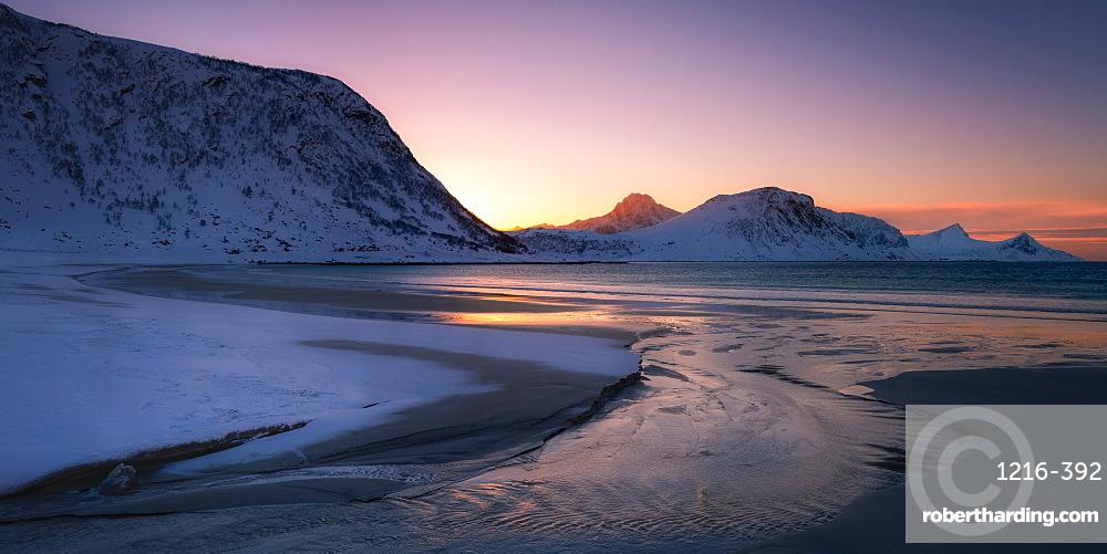 Snow covered Haukland Beach at sunset, Lofoten, Nordland, Norway, Europe