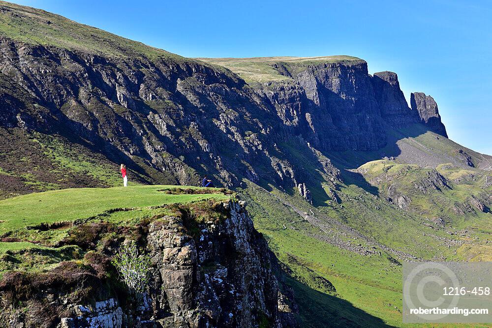 Tourists enjoying the beautiful views of the Quiraing, Isle of Skye, Scotland, United Kingdom