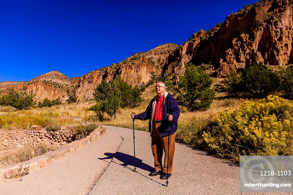 Old man walking through the Pueblo Indian Ruins in Bandelier National Monument, New Mexico, United States of America, North America