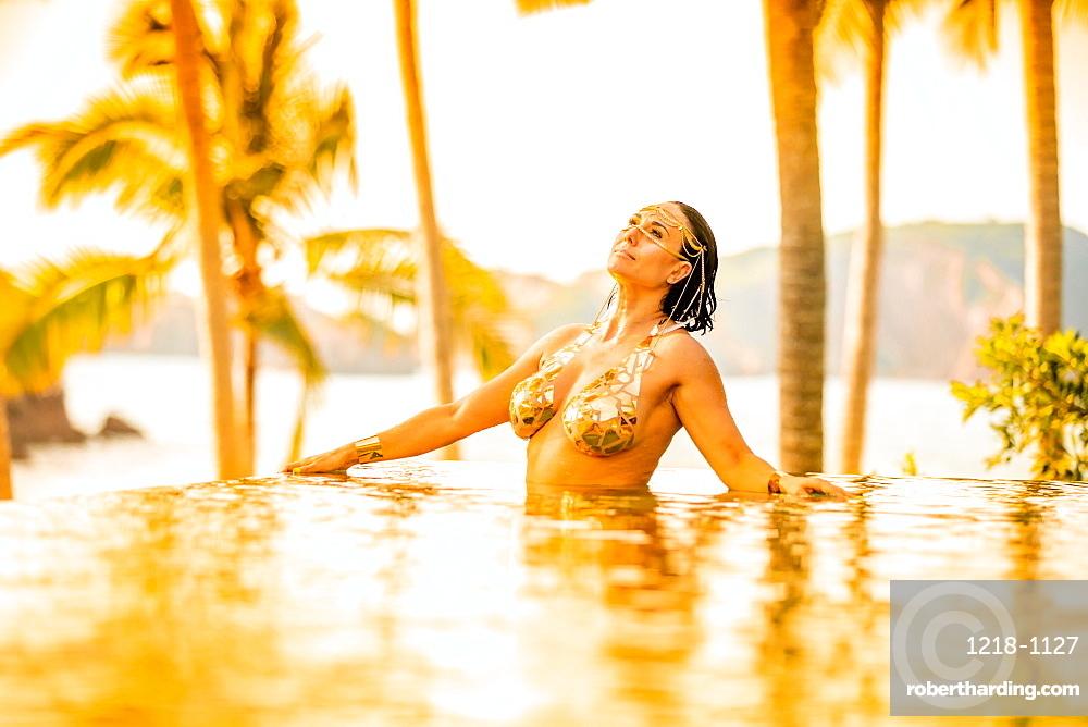 Ondalinda festival, Gold infinity pool photo shoot, El Careyes, Mexico, North America