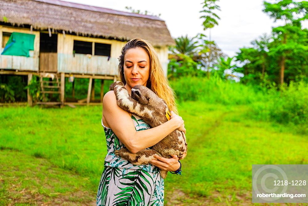 Visitor holding a local Sloth, Peru, South America