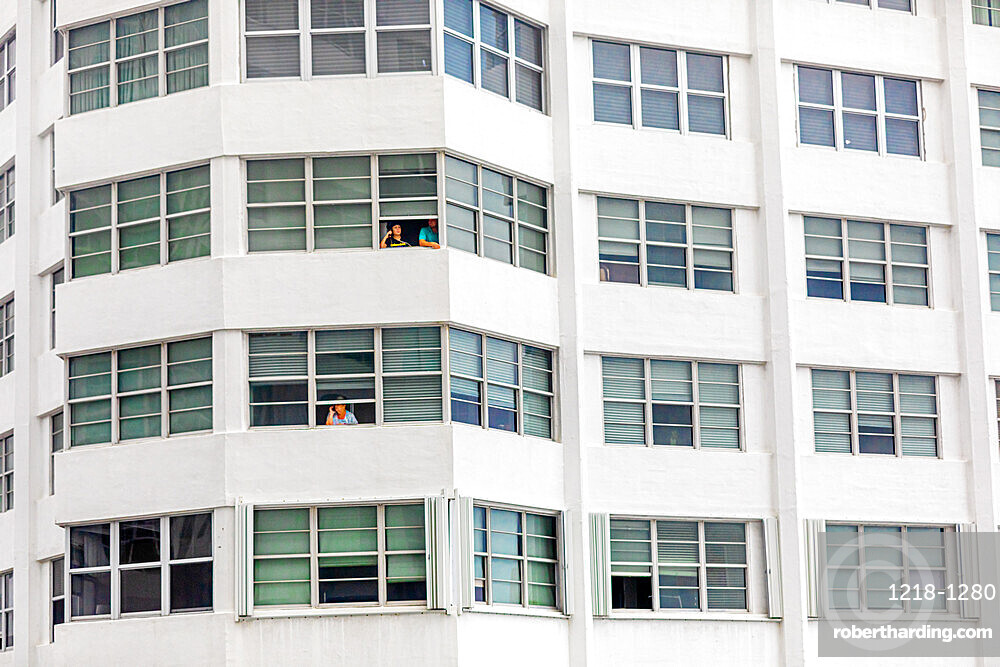 People without balconies cope with the pandemic lockdown through their windows at the Four Ambassadors Apartment Building, Miami, Florida, United States of America, North America