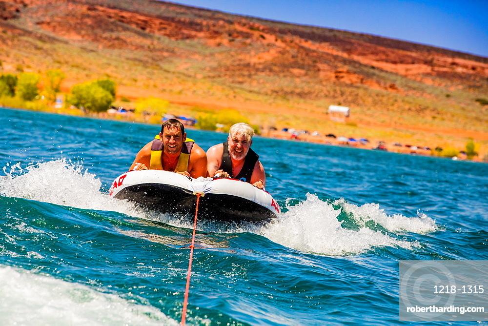 Two friends tubing in Utah, United States of America, North America