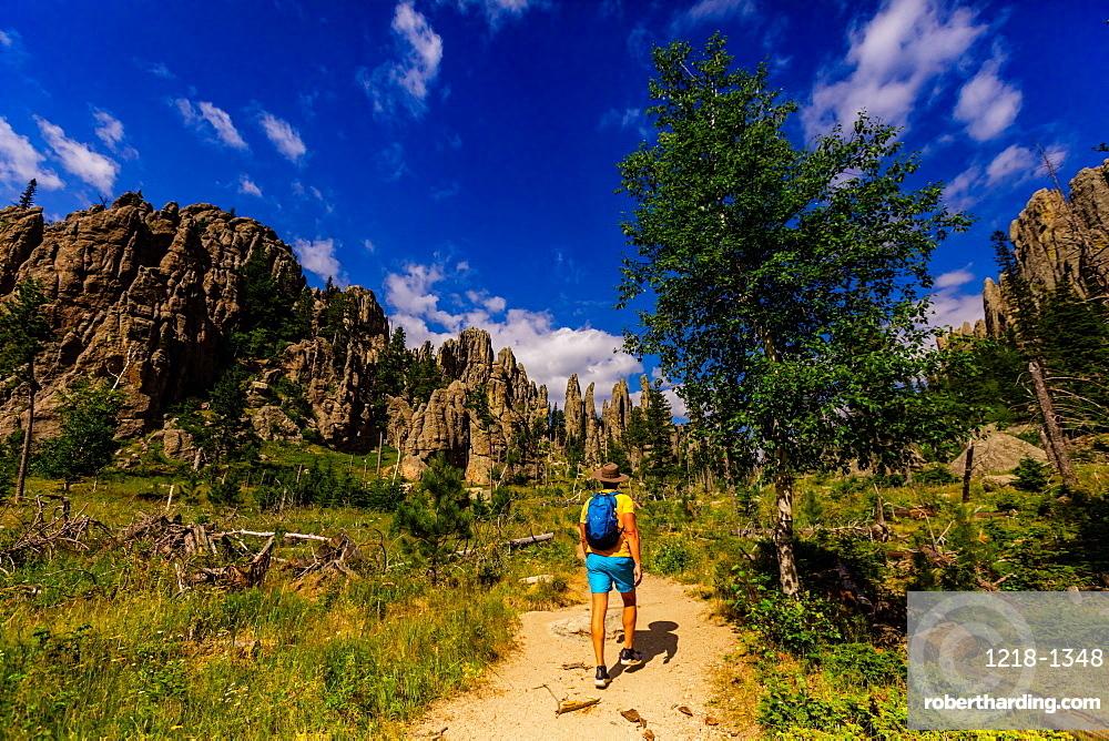 Man hiking the trails and enjoying the sights in the Black Hills of Keystone, South Dakota, United States of America, North America
